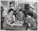 Women's Army Corps soldiers in day room playing Chinese Checkers