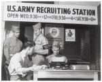 Soldiers and a recruit at a recruiting station