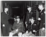Military Academy members sitting on porch of Guest House