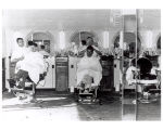 Men getting haircuts at a barbershop