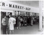 A line of people waiting outside the A & P market
