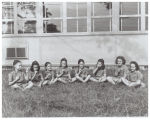 Brownie Scouts sitting outside Elm Grove School