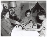 The Christopher family playing dominos