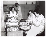 Women peeling potatoes at Central Cafeteria