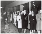 Women standing in line for nylons at Miller's Department Store