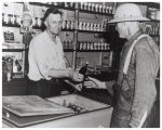 C. N. McKinney selling a soda to Sherman Hembree
