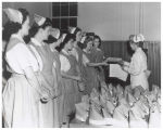 Red Cross nurses receiving their caps