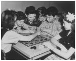 Children play checkers at Gamble Valley Community Center