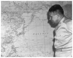 General Leslie R. Groves looking at a map of the Pacific