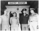 Generals standing at entrance to Guest House