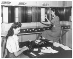 Two women working with the city directory