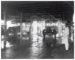 Buses getting washed at a terminal