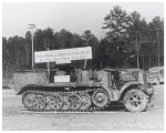 Enemy half-track on display at Ford, Bacon & Davis Construction Company