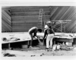 Workers building a pavilion at A. K.  Bissell Park