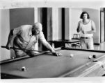 Two men play billiards at Civic Center