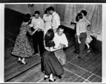 Four couples square dance
