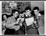 Teenagers performing a radio broadcast
