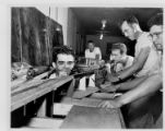 Men work on a model railroad