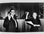 Louise Murphy administers the oath of office to Harry Wills