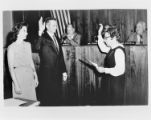Louise Murphy administers the oath of office to Edward S. Collins