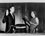 Louise Murphy administers the oath of office to a man