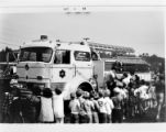 Children in line to view a fire engine
