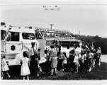 Children and women look at a fire engine