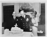 Lieutenant A. L. Hoffman cuts the cake at reception