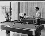 Three men play billiards at Civic Center