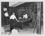 Men play billiards at the Senior Center