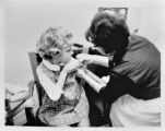 A child receives a vaccination