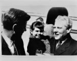 John F. Kennedy talks with Albert Gore, Sr. and a young girl