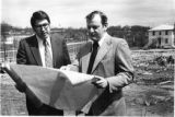 Ralph Aurin and John Byrne review site plans